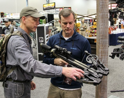 The author (left) checking out the HyperFlight EVO 420 in the Barnett booth during ATA 2020.