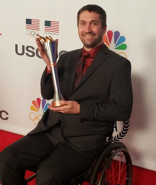 Ben Thompson with his award for 2019 Male Paralympic Athlete of the Year.