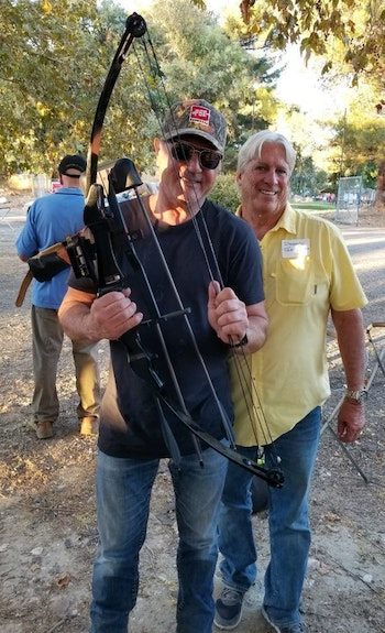 Frank Stallone holding the Rambo bow that Diamond Farnsworth (right) shot 37 years ago.