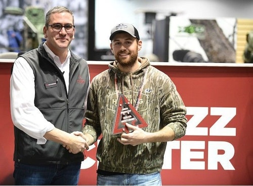 Aaron Warbritton (right) of The Hunting Public accepts an ATA Impact Award from ATA CEO/President Matt Kormann.
