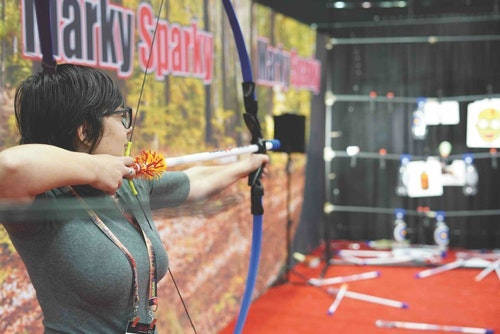 A shooter takes aim at the fun and entertaining Marky Sparky booth.