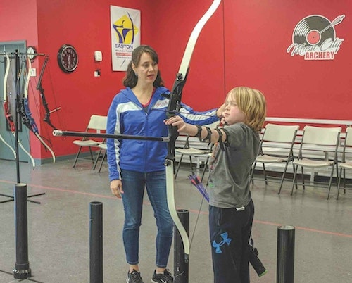 It's important to wear uniforms so that customers can readily identify you. Further, develop brand recognition among consumers by putting your logo out there, like Music City Archery has done on the back wall of its shooting range.