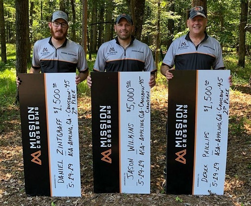 Jason Wilkins (center) celebrates his recent ASA/ProAm victory in Georgia with Mission Crossbows teammates Daniel Zintgraff (left) and Derek Phillips.
