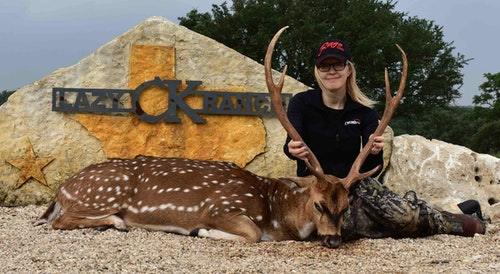 FeraDyne Media Manager Teri Quinn with a heavy-racked axis buck.