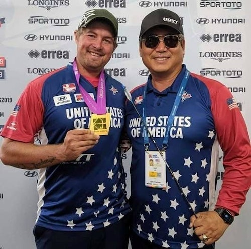 National Head Coach KiSik Lee (right) with Team USA's world champion archer Brady Ellison.