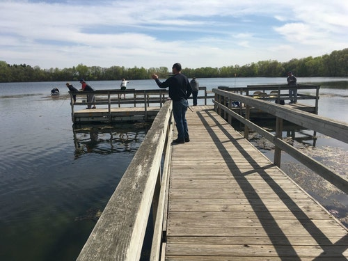 Minnesota panfish anglers practicing social distancing in early May on a public fishing dock.