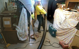 Using a Vacuum Trailer Attached to a HDPE Pipe, Contractor Unblocks Sewer Pipe for Homeowner