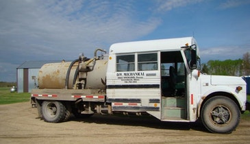 Half Vacuum Truck, Half School Bus Served Minnesota Pumper Well