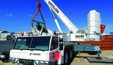 Crane lifts with minimal sway, telescopes into buildings