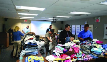 Vac-Con employees collect clothing, school supplies