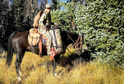 The author with her bow in the saddle scabbard, pursuing Colorado bulls.