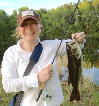 This is the first respectable largemouth bass the author ever caught on a fly rod at a farm pond in her hometown. Photo: Vivian Forrest