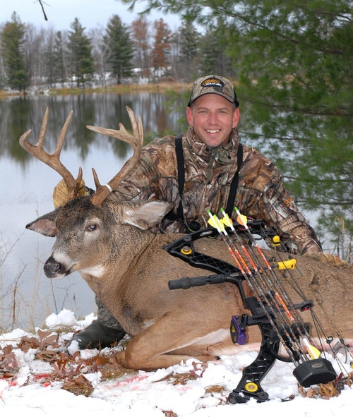 When shooting images of hunters with big game, it's usually best for a photographer to get close to the ground. When possible, keep an animal's antlers or horns positioned against a simple (non-busy) background. Here, the photographer framed the buck's rack with a background pond.