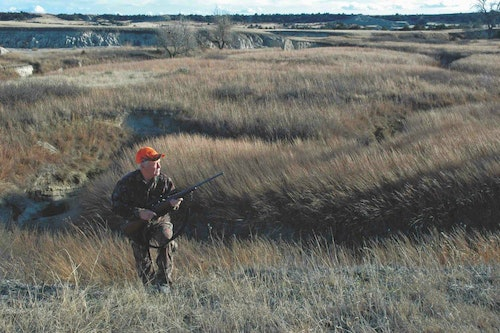 A labyrinth of coulees and the tall, thick grass on this Dakota prairie can hide loads of whitetails.