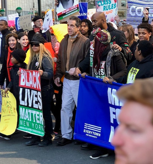 """New York Governor Andrew Cuomo at the lead of the NYC 2018 March For Our Lives rally. The NRA filed suit against Cuomo for claims of depriving the organization of its right to """"speak freely about gun-related issues and defend the Second Amendment."""" Photo: Er-nay (Wikipedia)"""