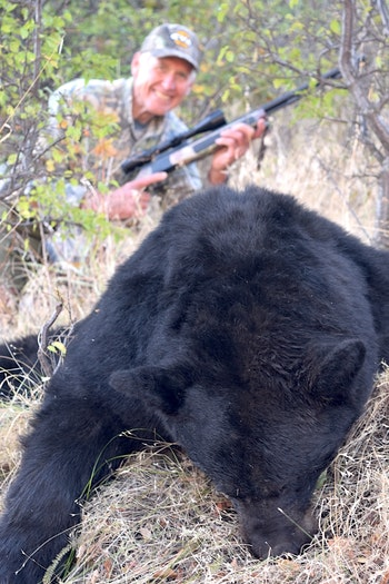 Wayne van Zwoll with a plum thicket bear that fell to his muzzleloader. (Photo: Wayne van Zwoll)