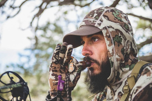 Mouth-blown predator calls can be used to effectively lure bears into archery range.