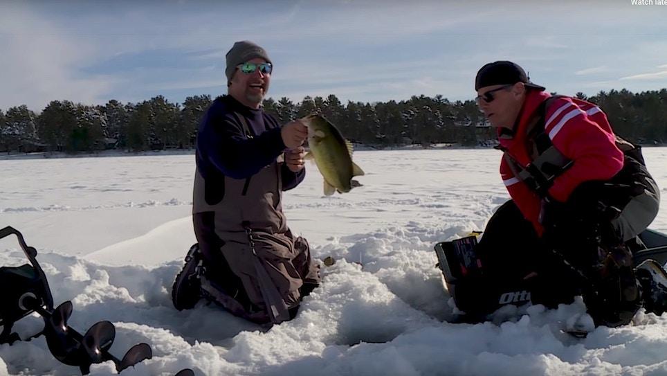 Underwater Ice Fishing Video: Bass Stalks Minnow Before Striking