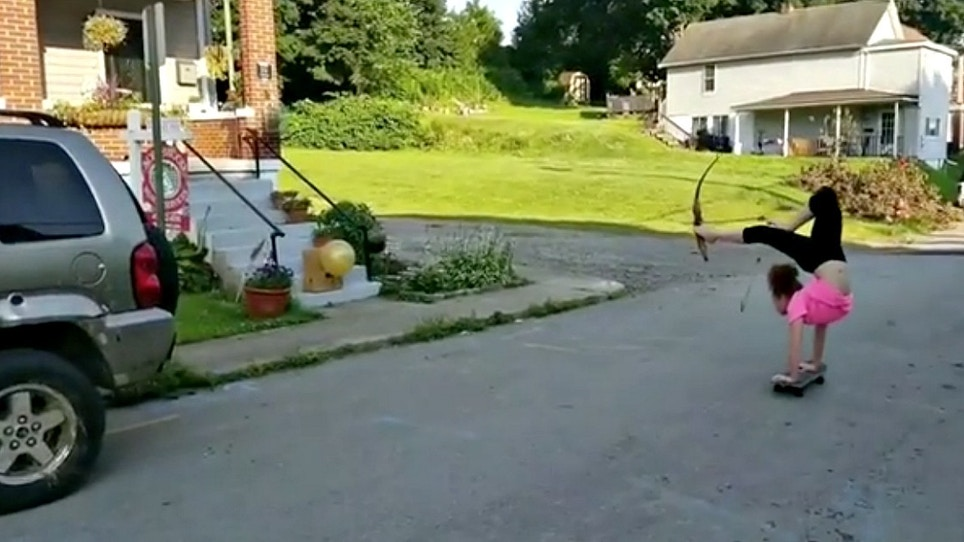 Tuesday Trick Shot: Recurve Bow, On a Skateboard, Doing a Handstand!