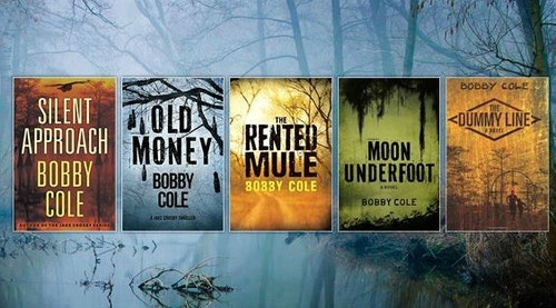 "Bobby Cole has written five books, which are shown above in order of pub date, from right to left: ""The Dummy Line"" (2008), ""Moon Underfoot"" (2013), ""The Rented Mule"" (2014), ""Old Money"" (2016) and ""Silent Approach"" (2017). Three books are in a series, and two titles (""The Rented Mule"" and ""Silent Approach"") are not."