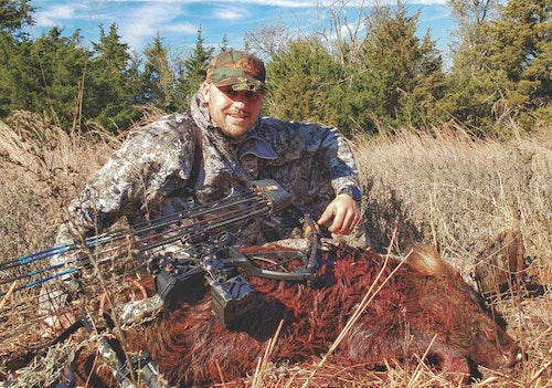 The author with his first-ever wild hog, shot on the Canton WMA in northwest Oklahoma.
