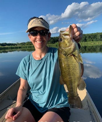 When summertime conditions are tough for bass, like midday under clear skies with little to no wind, it's hard to beat a jigworm fished deep and slow along the weedline.