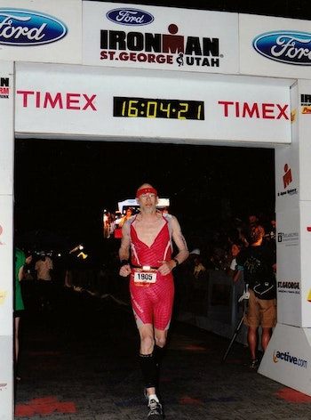 Bowhunter/athlete Dwight Schuh crossing an Ironman finish line.