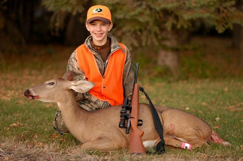 The author's oldest son killed this South Dakota whitetail with a recoil-free .243 bolt-action rifle fitted with 10 pounds of additional weight.