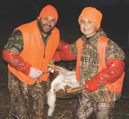 All gloved-up, Ralph and his son, RJ, get ready to field-dress RJ's very first whitetail buck, which just so happened to be a button buck. The duo was thrilled!