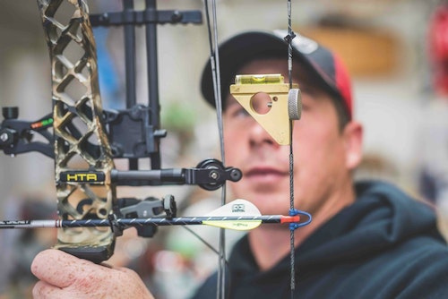A key in setting up a bow is to make sure the string loop is tied level with the arrow rest. It's also important to have the peep sight aligned correctly so you can immediately view your sight pins at full draw (below).