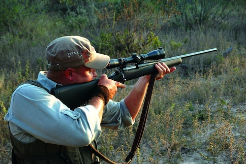 Offhand, you swing from knees, hips and shoulders. Arms and rifle track the target as a unit, no strain.​ (Photo: Wayne van Zwoll)