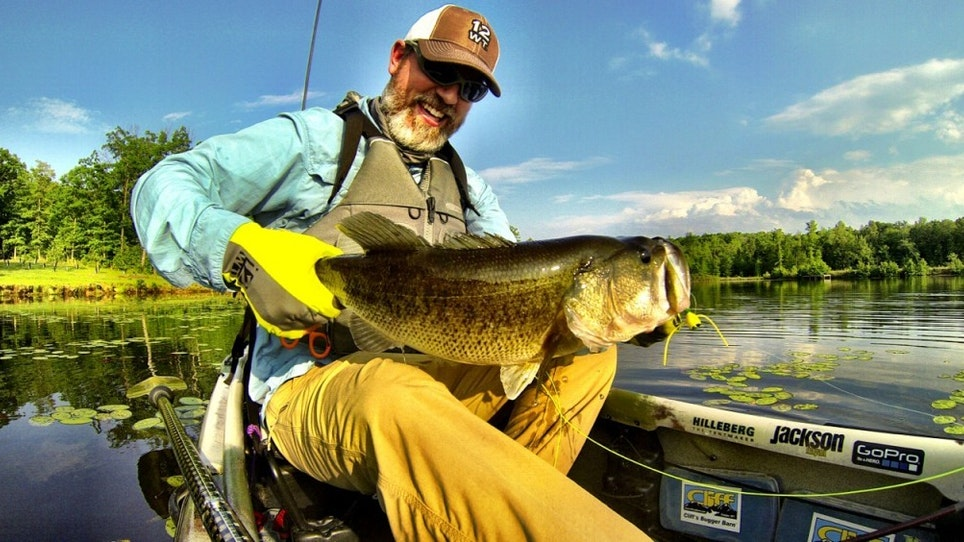 Damon Bungard of Jackson Kayak lands a bass while fishing the lily pads. Bungard is an avid angler and product manager for the kayak manufacturer. Jackson Kayak is known for its speciality fishing and hunting kayaks. Photo: Jackson Kayak