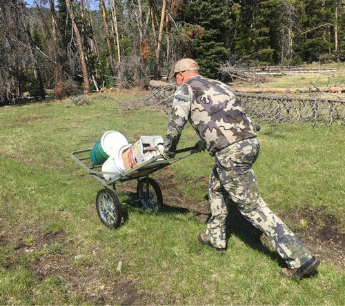 Hauling bait onto public lands that forbid motorized vehicles is a challenge. A cart such as the one shown here can also be used to haul out a bear if you're successful.