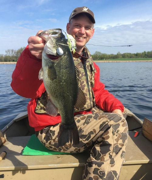 The author with a Minnesota spring largemouth caught on a main lake shoreline. The prespawn bass smoked a Northland Reed-Runner spinnerbait in color Whitetreuse.