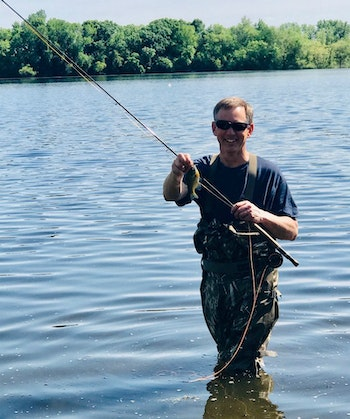 If you don't want to mess with live bait, you can still catch aggressive spawning sunfish on artificials. Here, the author chose a fly rod instead of spinning tackle for a change of pace.