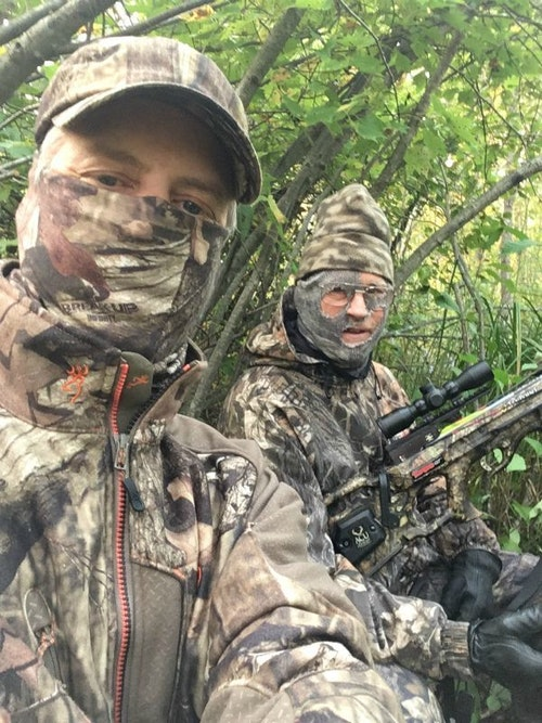 The author (left) and his 82-year-old father during a recent on-the-ground crossbow hunt in Wisconsin. To help avoid the keen eyes of whitetails, the pair wore face coverings.