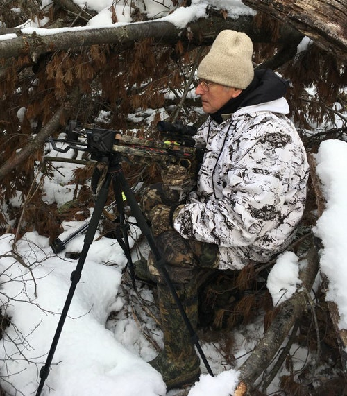 A sturdy tripod is the ideal way to rest a crossbow when hunting from the ground.