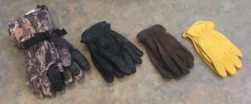 Because weather conditions change dramatically throughout deer season, you should own a variety of hunting gloves with different insulation qualities. The author's favorites are shown here. The camo gloves are the warmest, followed by insulated deer skin gloves (black). In warm conditions, he'll wear non-insulated deer skin gloves (dark brown). Note: Light-tan deer skin gloves (far right) are too bright for deer hunting; when hit by the sun, these gloves shine and will alert nearby whitetails.