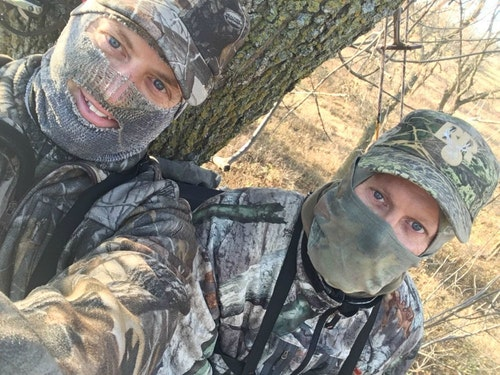 The author (left) and hunting partner Bill waiting on a South Dakota whitetail in a two-person ladder.