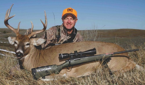 The author battled cattle daily before tagging this buck just as cows vacated an upland flat.