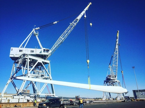 Think of a longshoreman as a shipping and receiving clerk on steroids. Here, Jordan lifts a wind mill blade that measures 208 feet long and weighs 30,000 pounds.