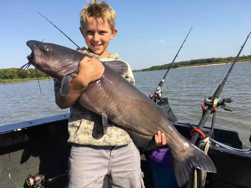 Luke hugs the longest fish of the trip, a 38-incher.
