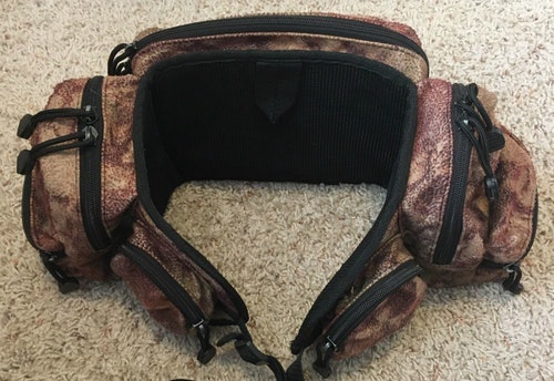 The author's ancient fanny pack, given to him by Trebark Founder Jim Crumley. It has three zippered pockets on each side (two small and one medium) and one larger zippered compartment in the back.