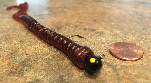 The author's go-to jigworm combo isn't expensive, but it's crazy good on weedline summertime largemouths. Shown here is a plain 1/8-ounce round jig head paired with a 7-inch Berkley PowerBait Powerworm in pumpkinseed color.