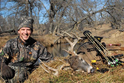 The first time the author, sitting butt on the ground in a pasture, used his fence-jumping bow-drawing trick he arrowed this mature buck as it approached a doe decoy.