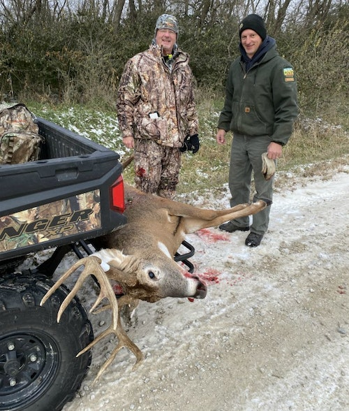 The author's Iowa host and friend, Mike Everhart, and Park Ranger Craig Oberbroeckling, helped load the massive buck onto Everhart's side-by-side.