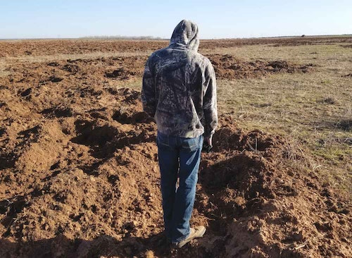 Hunt in areas where hogs frequent, such as agriculture fields they root seeking food.