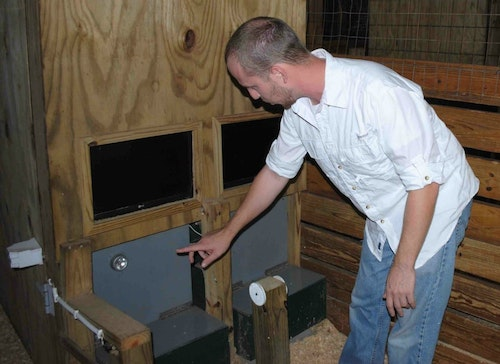 Research scientist Bradley Cohen, Ph.D., explains the device he used to first train deer to recognize light emitted from an LED, and then test them to see different colors and color intensities.