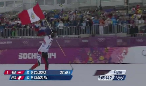 Cross-country skier Roberto Carcelen holds the Peruvian flag as he nears the finish line during the 2014 Winter Olympics. (Photo from Roberto Carcelen Facebook)