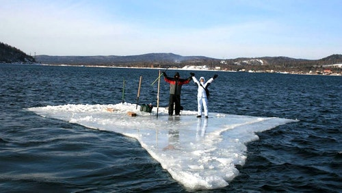 Two Russian anglers who were previously stranded on a large sheet of ice chose to paddle a smaller sheet of ice to safety. Photo courtesy of Russian Emergency Situations Ministry press service via AP.